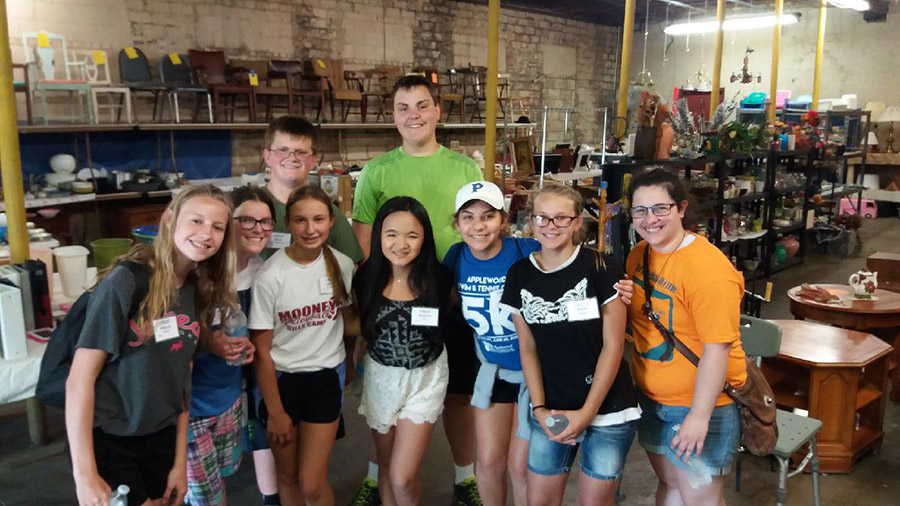 Student volunteers pose in front of our newly established thrift store in Youngstown, Ohio